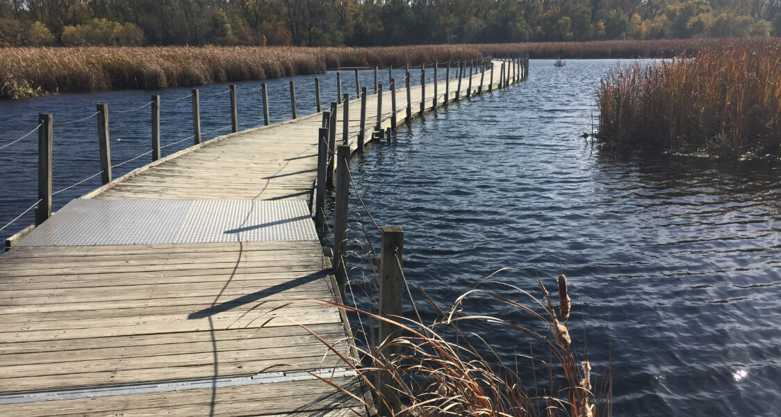 a long wooden walking bridge over water