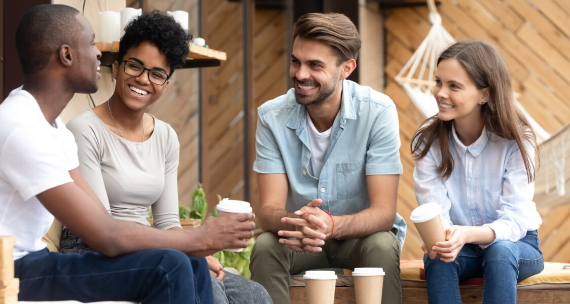 three friends talking and drinking coffee